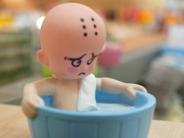 Toy doll in tub